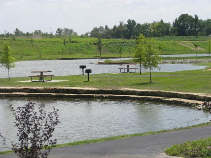 Pond at park with barbecue stand