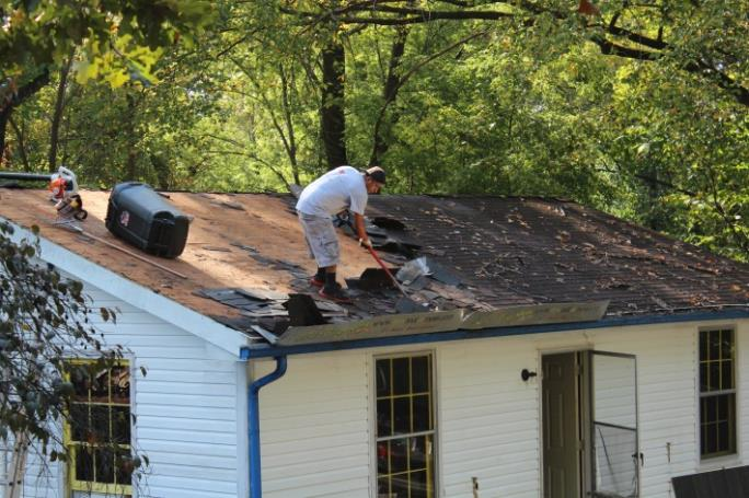 Volunteers repairing a roof